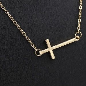 Jewelry - Gold cross necklace nwt